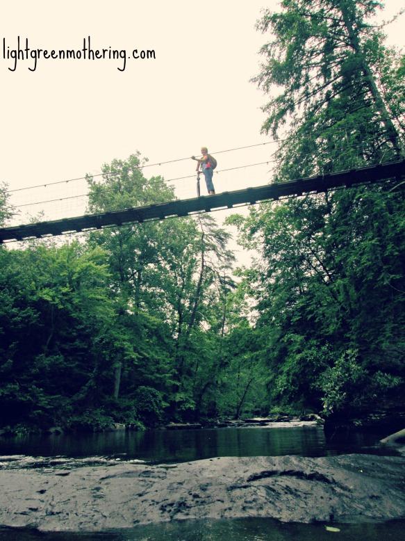 Babywearing on a bridge. ~lightgreenmothering.com